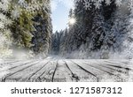 wooden table and winter snow... | Shutterstock . vector #1271587312