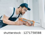 concentrated adult repairman... | Shutterstock . vector #1271758588