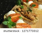 bruschetta with mozzarella... | Shutterstock . vector #1271773312