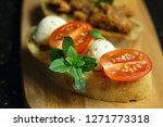 bruschetta with mozzarella... | Shutterstock . vector #1271773318