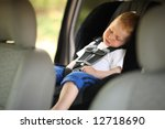 Boy Sleeping In Child Car Seat...