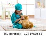 little child girl with doctor... | Shutterstock . vector #1271960668