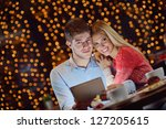 happy young couple with a... | Shutterstock . vector #127205615