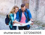 young travelers with a tourist... | Shutterstock . vector #1272060505