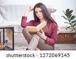 young girl sits on the floor in ...   Shutterstock . vector #1272069145