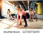 young tired athletes in a gym... | Shutterstock . vector #1272072655