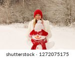 Girl In A Red Hat And Mittens...