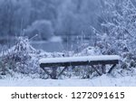 wooden bench a winters day in... | Shutterstock . vector #1272091615