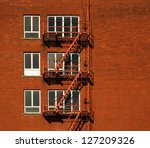 Red Brick Building With Three...