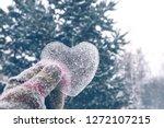 icy heart in hand. love... | Shutterstock . vector #1272107215