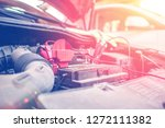 battery clamps connected to the ... | Shutterstock . vector #1272111382