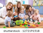 group of mothers with babies... | Shutterstock . vector #1272191518
