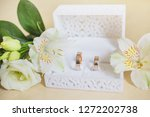 wedding rings in a white box.... | Shutterstock . vector #1272202738
