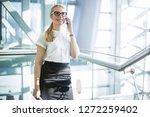 smiling woman managing director ... | Shutterstock . vector #1272259402