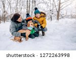 family with small yellow dog...   Shutterstock . vector #1272263998