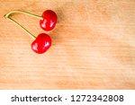 red cherries  on the wooden... | Shutterstock . vector #1272342808
