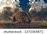 A Pair Of Ankylosauruses Graze...