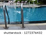 swimming pool in sunny day | Shutterstock . vector #1272376432
