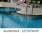 swimming pool in sunny day | Shutterstock . vector #1272376435