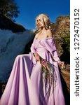 blonde woman in a long pink...   Shutterstock . vector #1272470152