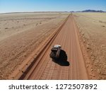 lonely 4x4 car driving through... | Shutterstock . vector #1272507892