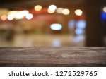empty dark wooden table in... | Shutterstock . vector #1272529765