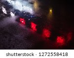reflections of a neon sign in... | Shutterstock . vector #1272558418