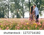 beautiful young couple holding... | Shutterstock . vector #1272716182