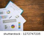 business report chart preparing ... | Shutterstock . vector #1272747235