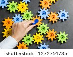 colourful cogwheels rotated by... | Shutterstock . vector #1272754735