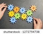 colourful cogwheels rotated by... | Shutterstock . vector #1272754738