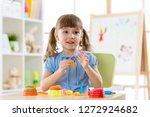 cute child playing with... | Shutterstock . vector #1272924682