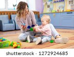 mother and child toddler play... | Shutterstock . vector #1272924685
