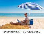 men using a laptop computer on...   Shutterstock . vector #1273013452