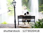 sweetheart couples sitting... | Shutterstock . vector #1273020418