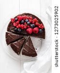 ut into pieces chocolate cake... | Shutterstock . vector #1273025902