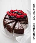 ut into pieces chocolate cake... | Shutterstock . vector #1273025905