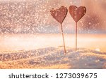wooden handmade heart in winter ... | Shutterstock . vector #1273039675