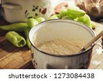 saucepan with cheese and green... | Shutterstock . vector #1273084438
