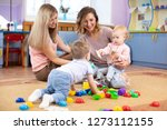 babies play and their moms... | Shutterstock . vector #1273112155