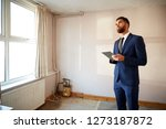 male realtor with digital... | Shutterstock . vector #1273187872