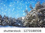 snowflakes falling from the sky.... | Shutterstock . vector #1273188508