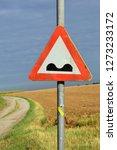 speed bump warning sign in... | Shutterstock . vector #1273233172