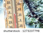 thermometer on snow shows low... | Shutterstock . vector #1273237798