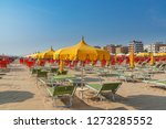 umbrellas and chaise lounges on ... | Shutterstock . vector #1273285552