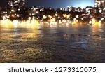 wet street in front of night... | Shutterstock . vector #1273315075