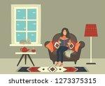 woman in cozy armchair reading... | Shutterstock .eps vector #1273375315