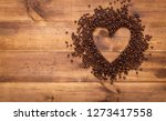 black coffee beans seed in... | Shutterstock . vector #1273417558