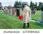 sorrowful man brings flowers to ...   Shutterstock . vector #1273584262