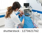 beautiful young female dentist...   Shutterstock . vector #1273621762
